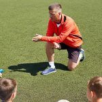 Coach focused on mastery coaching with his junior soccer team. No exercise punishment.
